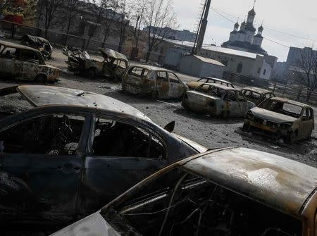 Burnt-out vehicles are seen at a residential sector in Mariupol, a city on the Sea of Azov, eastern Ukraine
