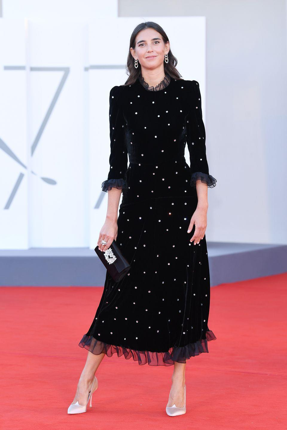 <p>Viola Arrivabene wears a black velvet dress by Philosophy di Lorenzo Serafini, shoes by Roger Vivier, and jewelry by Pomellato. </p>