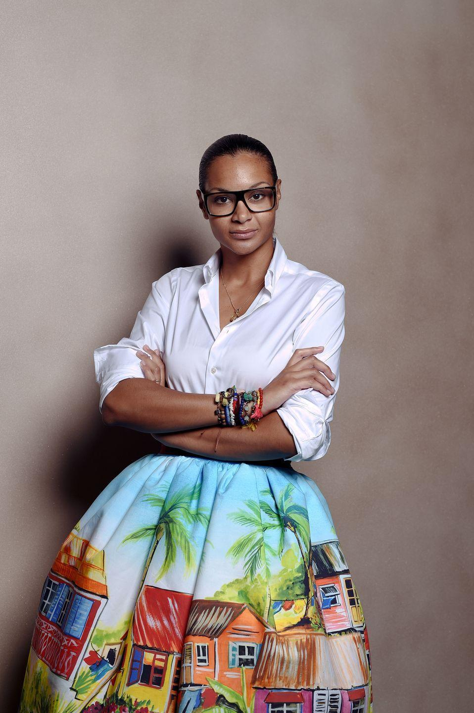 "<p>Stella Jean was and raised in Rome by a Haitian mother and Italian father at <a href=""https://www.forbes.com/sites/liviahengel/2019/06/25/how-this-haitian-italian-designer-takes-local-fashion-global/#440e49676b2e"" rel=""nofollow noopener"" target=""_blank"" data-ylk=""slk:&quot;a time when the country was completely unprepared for multicultural families like mine"" class=""link rapid-noclick-resp"">""a time when the country was completely unprepared for multicultural families like mine</a>...people constantly stopped in the streets to point at us."" But Jean credits her mixed background for her later success: Jean took her father's basic button-down shirts and mixed them with bright fabrics. This led to her main source of design inspiration: combining different cultures. Jean won <em>Vogue Italy</em>'s ""Who Is On Next?"" competition in 2011. In 2014, Giorgio Armani showcased Stella Jean's collection at the Armani theatre in Milan, and she was the first womenswear designer to present in the iconic space. That same year, Jean collaborated with Christian Louboutin on a shoe collection. With high-profile collaborations under her belt, Jean was invited by the UN International Development Organization to join an ethical fashion program. Jean has also garnered an impressive list of celebrity clientele, including Beyonce and Rihanna. Even with all of her global attention, Jean believes fashion shouldn't be exclusive. By inviting craftsmen and artisans to sit front row at her shows, she honors the people who made it all possible.</p>"