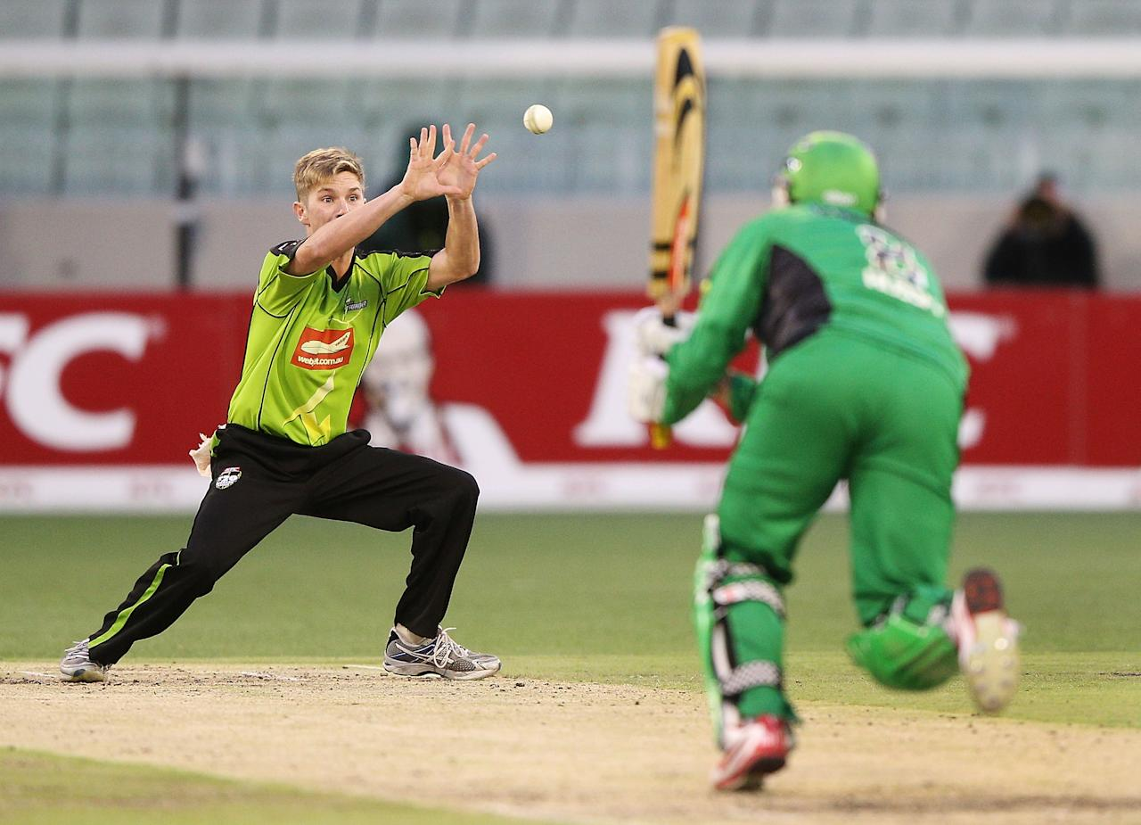 MELBOURNE, AUSTRALIA - JANUARY 08:  Adam Zampa of the Sydney Thunder misses a catch to dismiss David Hussey of the Melbourne Stars during the Big Bash League match between the Melbourne Stars and the Sydney Thunder at Melbourne Cricket Ground on January 8, 2013 in Melbourne, Australia.  (Photo by Michael Dodge/Getty Images)