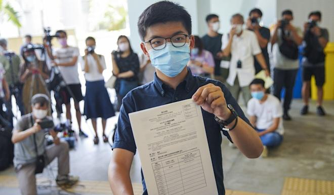 Joshua Wong files his candidacy for the Legislative Council elections in September in Hong Kong. Photo: Winson Wong