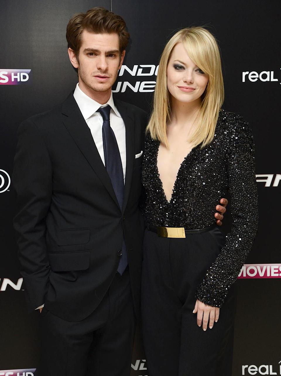 <p>Andrew Garfield and Stone began dating while filming <em>The Amazing Spider-Man.</em> The private couple posed together at the London premiere on June 18, 2012. (Photo: Dave Hogan/Getty Images) </p>