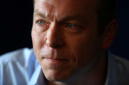 FILE PHOTO: Olympic cyclist Chris Hoy listens to a question during a news conference at which he announced his retirement from the sport, at Murrayfield stadium in Edinburgh, Scotland April 18, 2013.    REUTERS/David Moir/File Photo