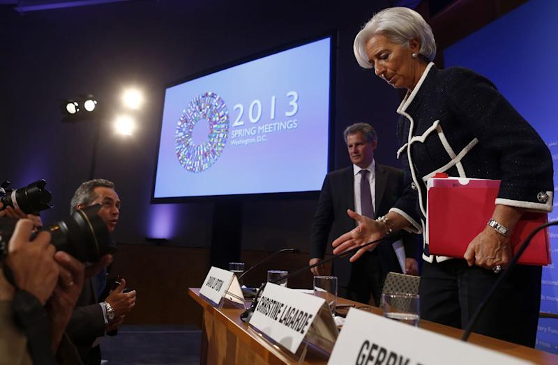 International Monetary Fund (IMF) Managing Director Christine Lagarde is questioned by reporters as she leaves a news conference during the Spring Meetings of the World Bank Group and the International Monetary Fund in Washington, Thursday, April 18, 2013. (AP Photo/Charles Dharapak)