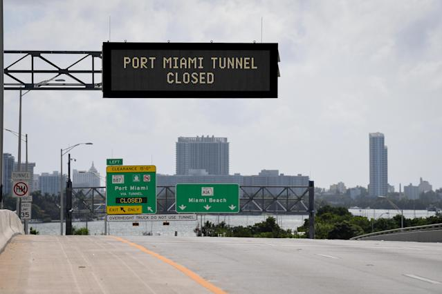 <p>Signs warning of road closures are seen above the road in Miami Beach, Fla., Sept. 8, 2017. (Photo: Bryan Woolston/Reuters) </p>