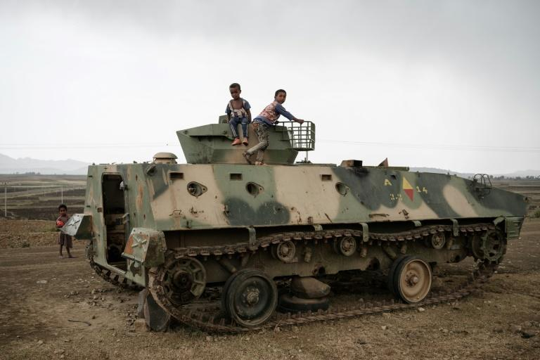 Children play on a tank allegedly from the Ethiopian army which was abandoned near Dengolat, southwest of the Tigrayan capital Mekele