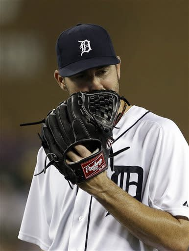 Detroit Tigers starting pitcher Justin Verlander reacts on his walk back to the dugout after being pulled during the eighth inning of a baseball game against the Chicago White Sox in Detroit, Tuesday, July 9, 2013. (AP Photo/Carlos Osorio)