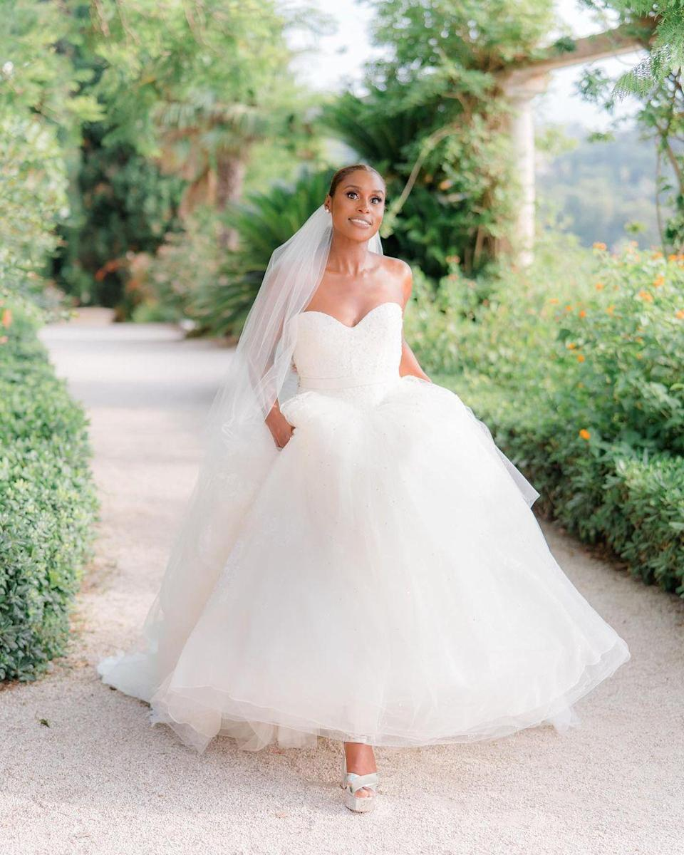 """<p>The <em>Insecure </em>writer and star <a href=""""https://people.com/style/all-about-issa-raes-vera-wang-wedding-dress-and-wedding-day-glam/"""" rel=""""nofollow noopener"""" target=""""_blank"""" data-ylk=""""slk:wore a romantic custom Vera Wang Haute ballgown"""" class=""""link rapid-noclick-resp"""">wore a romantic custom Vera Wang Haute ballgown</a> with matching veil to wed longtime boyfriend Louis Diame in the south of France — <a href=""""https://people.com/style/all-about-issa-raes-vera-wang-wedding-dress-and-wedding-day-glam/"""" rel=""""nofollow noopener"""" target=""""_blank"""" data-ylk=""""slk:then changed into another one for the reception"""" class=""""link rapid-noclick-resp"""">then changed into another one for the reception</a>. </p>"""