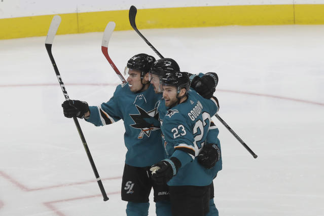 San Jose Sharks' Tomas Hertl, middle, is congratulated by Timo Meier, left, and Barclay Goodrow after scoring against the Nashville Predators during the third period of an NHL hockey game in San Jose, Calif., Saturday, Nov. 9, 2019. The Sharks won 2-1 in a shootout. (AP Photo/Jeff Chiu)