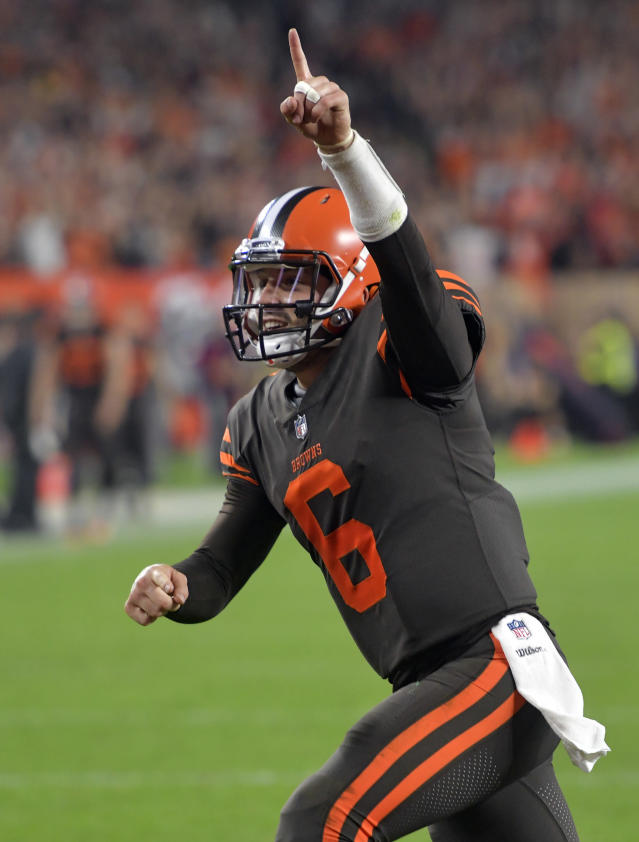 Cleveland Browns quarterback Baker Mayfield celebrates a 1-yard touchdown by Cleveland Browns running back Carlos Hyde during the second half of an NFL football game against the New York Jets, Thursday, Sept. 20, 2018, in Cleveland. (AP Photo/David Richard)