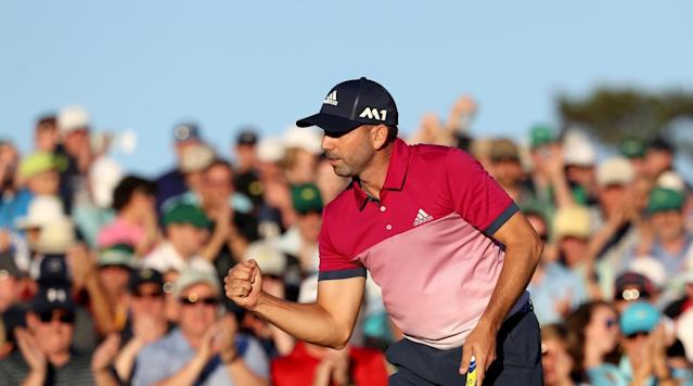 Sergio Garcia reacts to making his par putt on the 18th hole on Saturday.