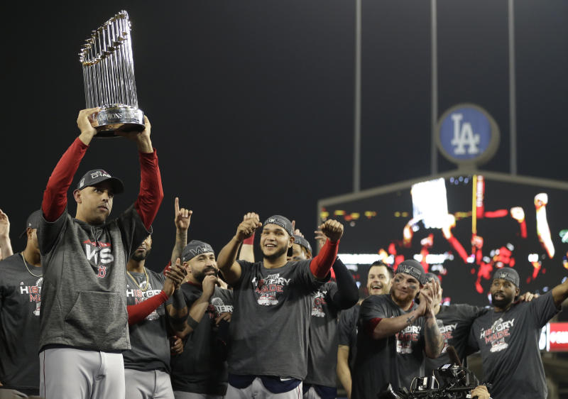 Boston Red Sox manager Alex Cora holds the championship trophy after Game 5 of baseball's World Series against the Los Angeles Dodgers on Sunday, Oct. 28, 2018, in Los Angeles. The Red Sox won 5-1 to win the series 4 game to 1.