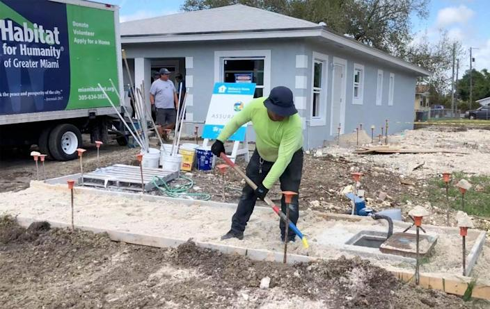 A squad of volunteers and soon-to-be homeowners works to finish eight Habitat for Humanity of Greater Miami houses in the South Miami-Dade neighborhood of Goulds as part of the nonprofit's annual Blitz Build. The nonprofit just marked its 30th year of operation in Miami.