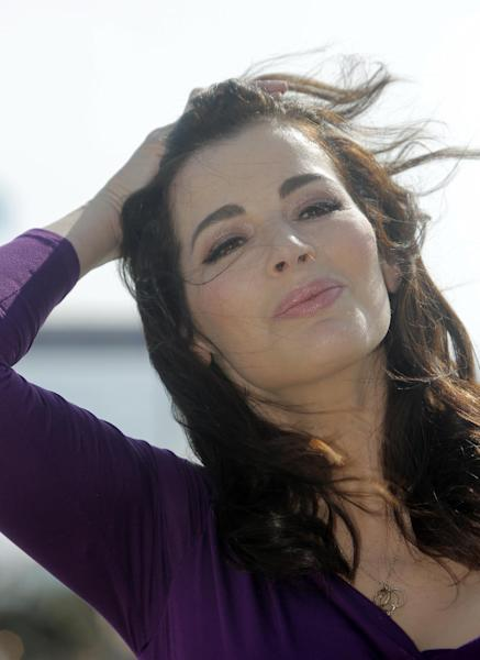 FILE - In this Tuesday, Oct. 9, 2012 file photo, English food writer, journalist and broadcaster, Nigella Lawson poses during the 28th MIPCOM (International Film and Programme Market for Tv, Video,Cable and Satellite) in Cannes, southeastern France. British police say they are investigating after a newspaper published photos of Nigella Lawson's husband Charles Saatchi with his hands around the celebrity chef's throat. The Sunday People newspaper ran pictures of what it said was the couple's violent argument at a London restaurant on June 9, 2013. (AP Photo/Lionel Cironneau, File)