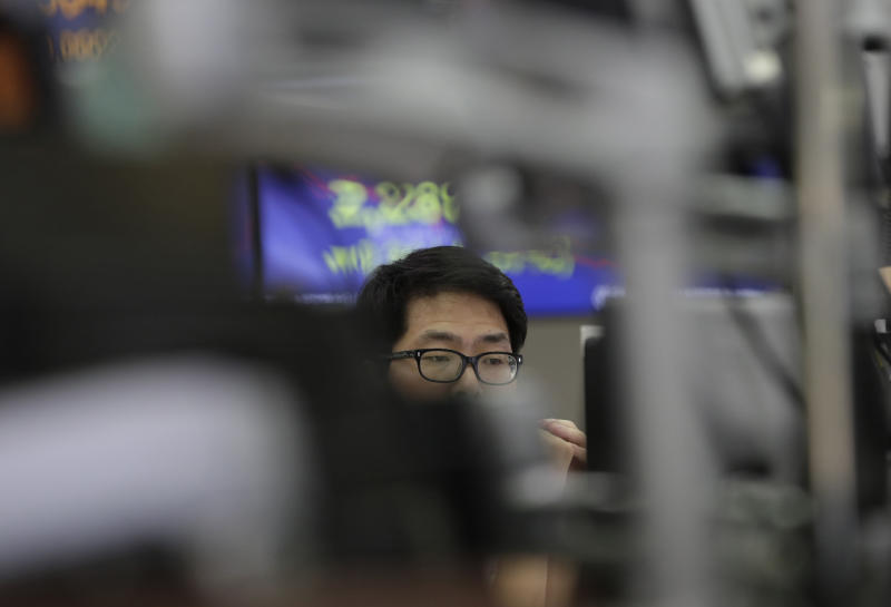 A currency trader watches monitors at the foreign exchange dealing room in Seoul, South Korea, Thursday, July 19, 2018. Asian stock markets drifted without a clear direction on Thursday while investors wait and see further developments on global trade disputes. (AP Photo/Lee Jin-man)