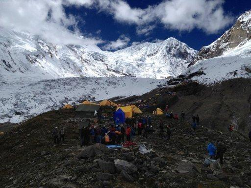 <p>In this handout photograph released by Nepalese helicopter aviation service Simrik Air, rescuers are pictured at a site following an avalance at Manaslu in Gorkha District. Rescuers have scaled down a search for two French climbers and a Canadian missing in a Nepal avalanche which killed at least nine people attempting to scale one of the world's highest peaks.</p>
