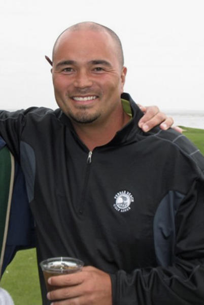 This 2011 cell phone image provided by golfmanna.com, shows Mark Mihal, 43, a mortgage broker from Creve Couer, Mo., during a golf outing at the Pebble Beach Golf Links in Pebble Beach, Calif. On March 8, 2013, Mihal fell into an 18-foot-deep and 10-foot-wide sinkhole while playing golf at the Annbriar Golf Course in Waterloo, Ill. Mihal was hoisted to safety with a rope and suffered a dislocated shoulder. (AP Photo/Courtesy of golfmanna.com, C.A. Schmidt)