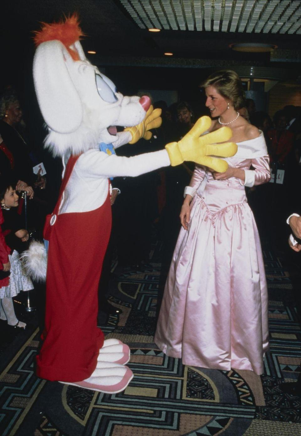 <p>The star of <em>Who Framed Roger Rabbit </em>wears his usual garb, while Princess Diana wore an off-the-shoulder pink satin Catherine Walker ball gown at the premiere in London. </p>