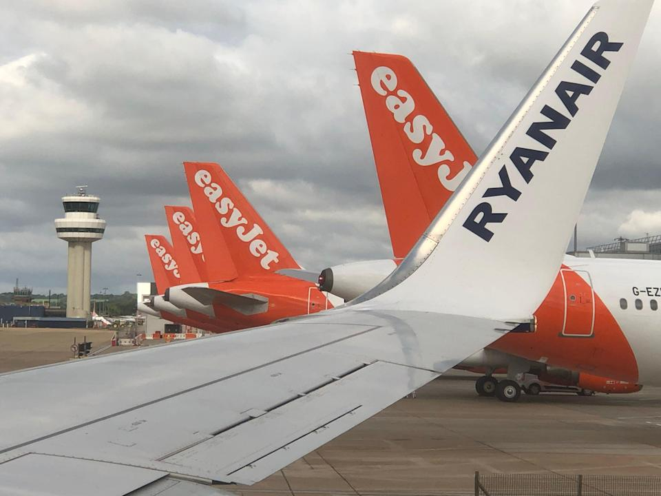<p>Safe bets: the view from a Ryanair plane of easyJet tailfins at Gatwick airport</p> (Simon Calder)