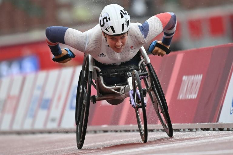 Britain's 'Hurricane' Hannah Cockroft comes home well clear of the field to win the T33 800m in Tokyo (AFP/Kazuhiro NOGI)