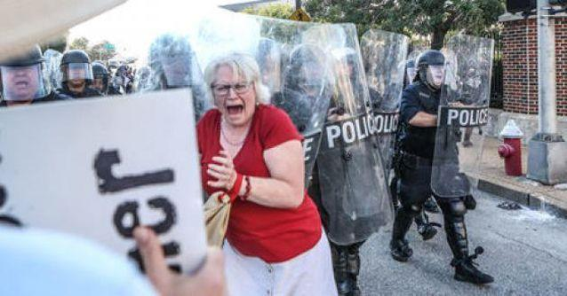 Police marched on protesters after they refused to leave the centre of St Louis. Source: Reuters