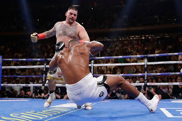 Andy Ruiz punches Anthony Joshua during the third round Saturday in New York. Ruiz stopped Joshua in the seventh round. (AP)