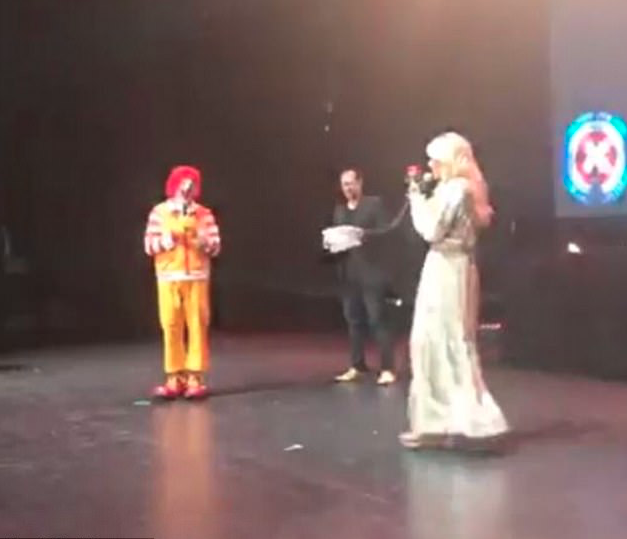 Sophie Monk posted a snap of herself giving a rose to Ronald McDonald onstage at the charity event. Source: Instagram