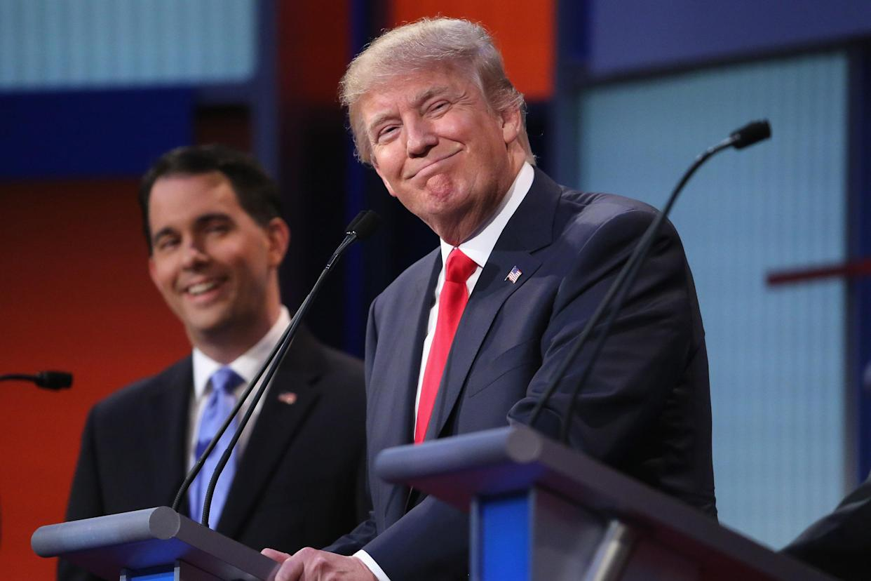 Republican presidential candidates Donald Trump and Wisconsin Gov. Scott Walker participate in a debate in Cleveland. (Photo: Chip Somodevilla/Getty Images)