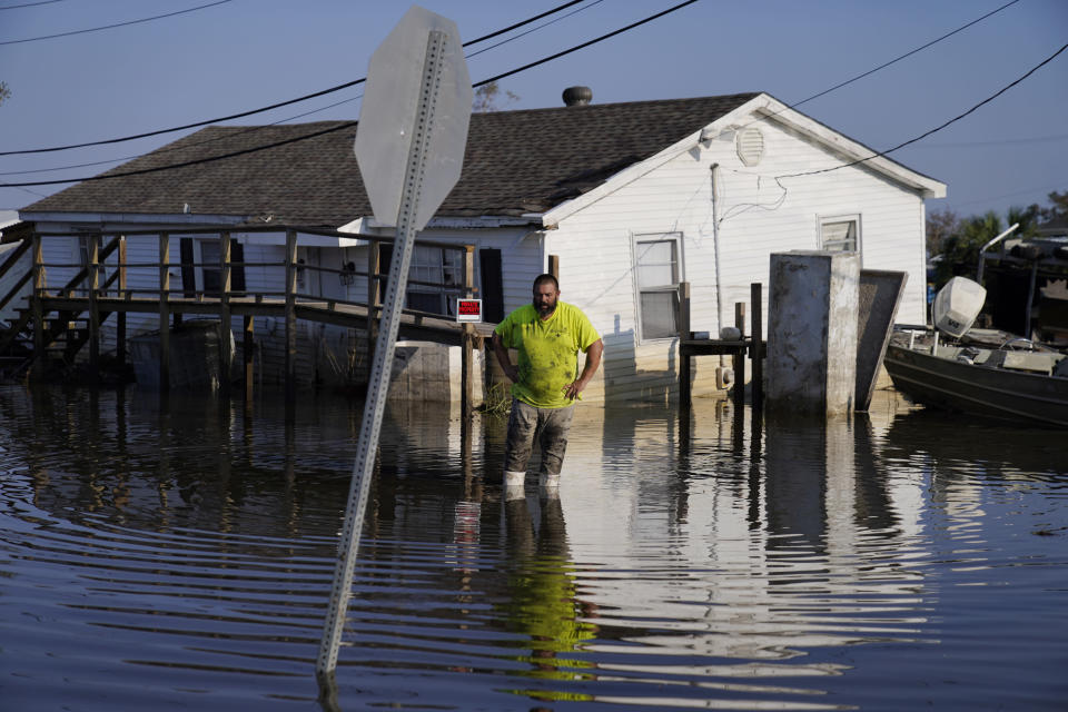 """Nathan Fabre checks on his home and boat destroyed by Hurricane Ida, Sunday, Sept. 5, 2021, in Lafitte, La. """"We lost everything,"""" said Fabre about the destruction of his home. (AP Photo/John Locher)"""