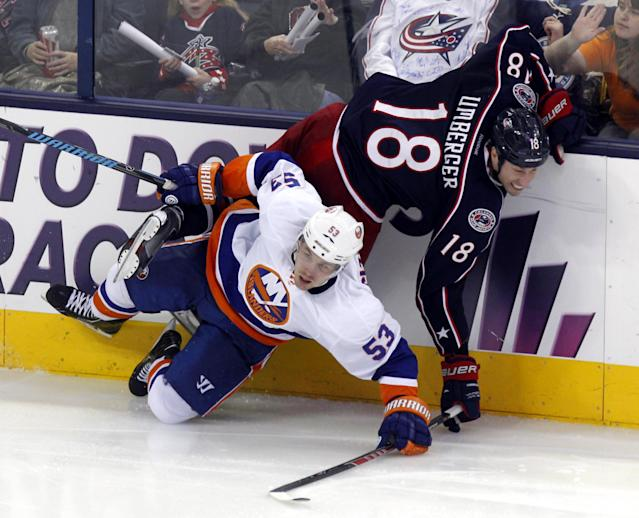 Columbus Blue Jackets' R.J. Umberger, top, collides with New York Islanders' Casey Cizikas in the third period of an NHL hockey game in Columbus, Ohio, Sunday, April 6, 2014. The Blue Jackets won 4-0. (AP Photo/Paul Vernon)