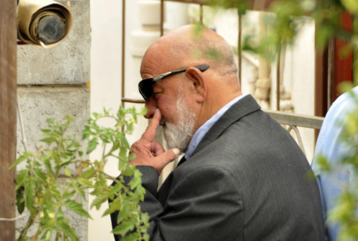 Barry Steenkamp, the father of Reeva Steenkamp, leaves his home to attend her funeral ceremony in Port Elizabeth, South Africa, Tuesday, Feb. 19, 2013. Olympic athlete Oscar Pistorius is charged with the premeditated murder of Steenkamp on Valentine's Day. The defense lawyer says it was an accidental shooting. (AP Photo/Schalk van Zuydam)