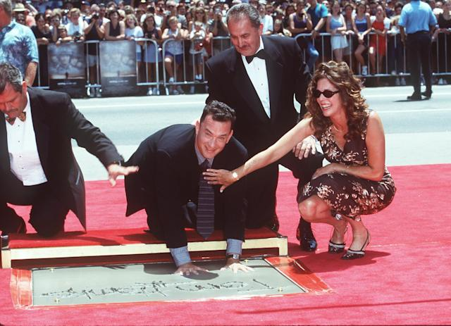 Hanks and Wilson are all smiles as he places his hands in cement at Mann's Chinese Theatre in Hollywood in 1998. (Photo: SGranitz/WireImage)