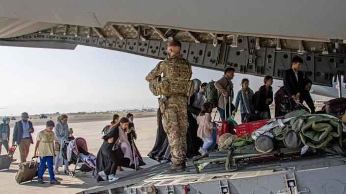 Afghans board a UK C-17 aircraft