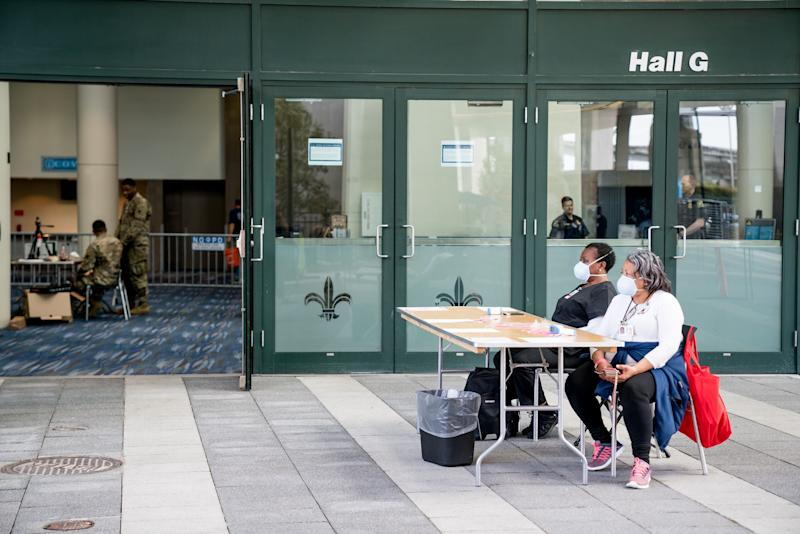 Louisiana Health Department Nursing Staff wait to check IDs and take temperatures of people wishing to enter the New Orleans Ernest N. Morial Convention Center on April 6, 2020. (Photo: Claire Bangser/AFP via Getty Images)