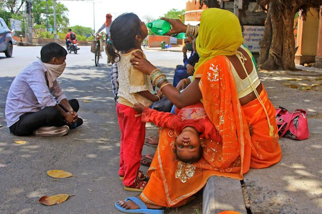 Migrants rest as they walk towards their native places during the nation wide lockdown imposed due to deadly novel coronavirus pandemic in Jaipur,Rajasthan, India,May 13,2020.(Photo by Vishal Bhatnagar/NurPhoto via Getty Images)