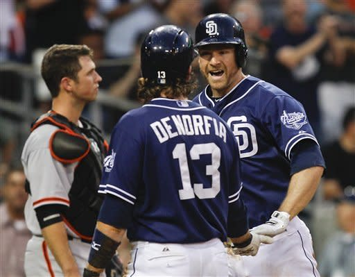 San Diego Padres' Chase Headley is congratulated by Chris Denorfia after hitting a two-run home run against the San Francisco Giants during the third inning of a baseball game Saturday, Sept. 29, 2012 in San Diego. (AP Photo/Lenny Ignelzi)