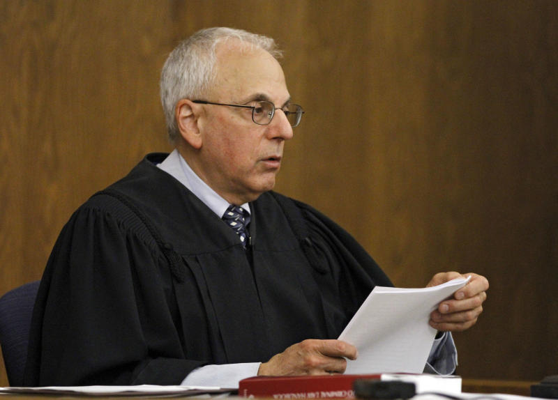 Cuyahoga County Judge Stuart Friedman reads his ruling on a death penalty case in Cleveland,  Friday, June 15, 2012. Friedman ruled that condemned murderer Abdul Awkal is not mentally competent to be executed for the death of his estranged wife and brother-in-law in 1992. The decision comes just a week after Ohio Gov. John Kasich ordered a last-minute reprieve, hours before Awkal was set to die. (AP Photo/Mark Duncan)
