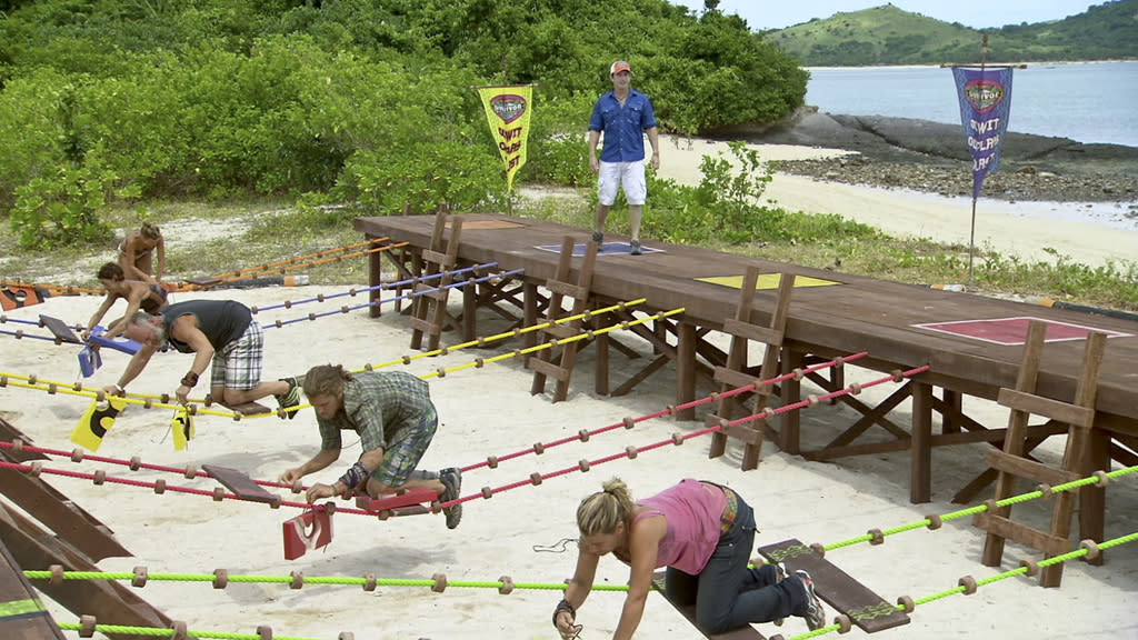 "Jeff Probst looks on as Abi-Maria Gomes, Denise Stapley, Michael Skupin, Malcolm Freberg and Lisa Whelchel compete during the Immunity Challenge in the ""Survivor: Philippines"" episode, ""Gouge My Eyes Out."""