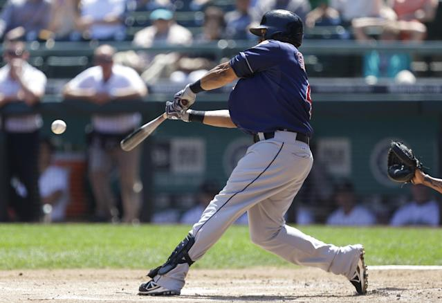 Cleveland Indians' Carlos Santana hits a ground-rule RBI double against the Seattle Mariners in the first inning of a baseball game, Wednesday, July 24, 2013, in Seattle. (AP Photo/Ted S. Warren)