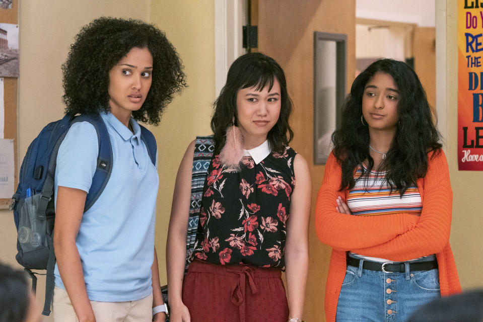 NEVER HAVE I EVER (L to R) LEE RODRIGUEZ as FABIOLA TORRES, RAMONA YOUNG as ELEANOR WONG, and MAITREYI RAMAKRISHNAN as DEVI VISHWAKUMAR in episode 101 of NEVER HAVE I EVER Cr. LARA SOLANKI/NETFLIX © 2020