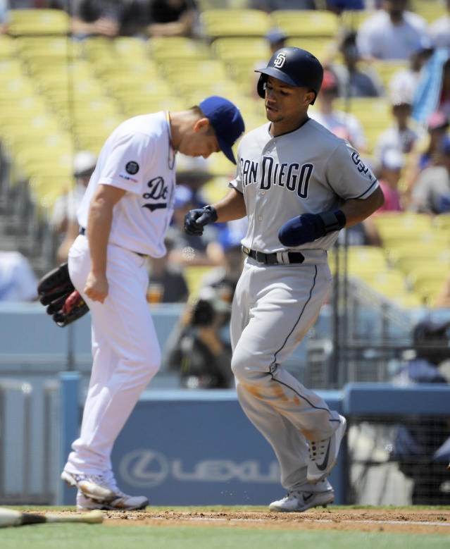 San Diego Padres' Francisco Mejia, right, scores on a single by Chris Paddack as Los Angeles Dodgers starting pitcher Kenta Maeda, of Japan, stands in the background during the third inning of a baseball game Sunday, Aug. 4, 2019, in Los Angeles. (AP Photo/Mark J. Terrill)