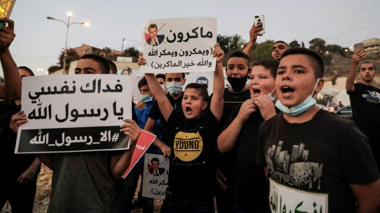 Arab Israeli Muslim demonstrators protest against the comments by French President Emmanuel Macron, in the Arab town of Umm al-Fahem in northern Israel on Sunday
