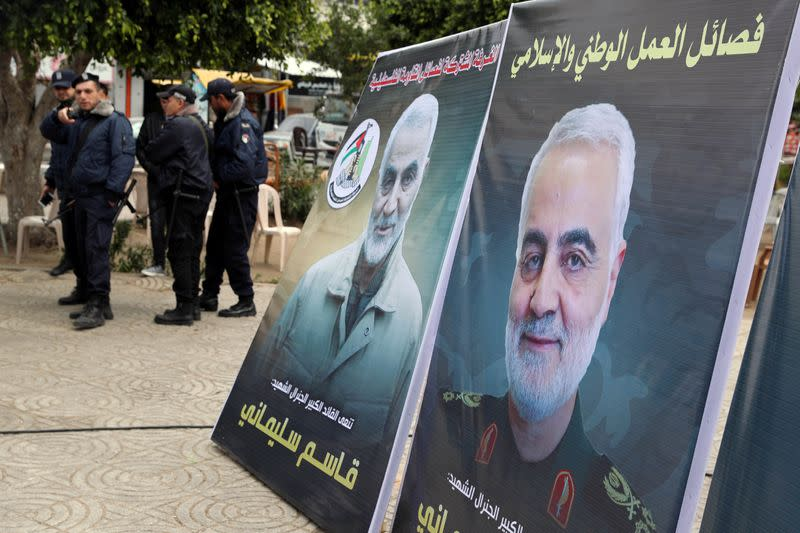 Pictures of Iranian Major-General Qassem Soleimani are seen during a protest against the killing of Soleimani, in Gaza