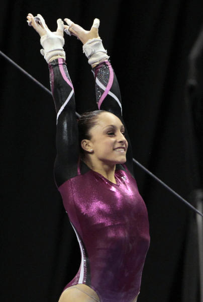 Jordyn Wieber smiles after completing her uneven-bar routine at the U.S. gymnastics championships Sunday, June 10, 2012, in St. Louis. Wieber took the overall title. (AP Photo/Jeff Roberson)