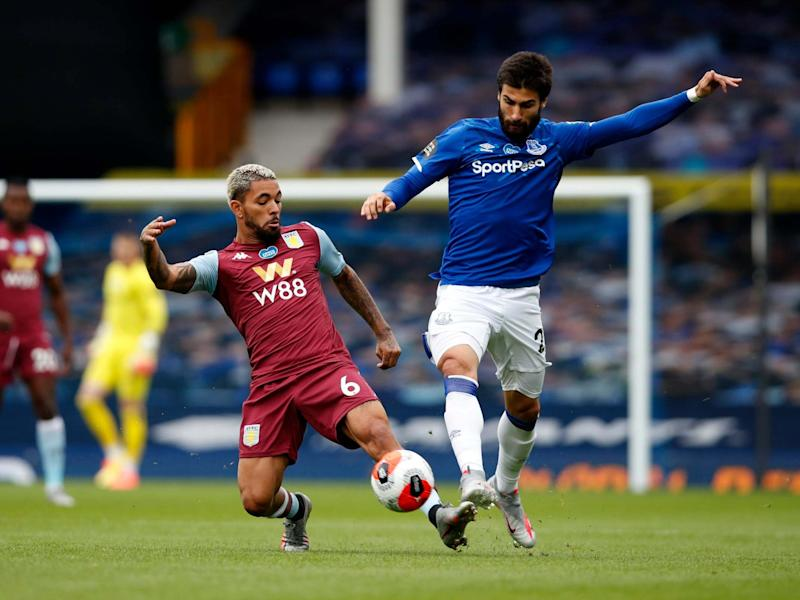 Douglas Luiz of Aston Villa tackles Andre Gomes: Getty Images