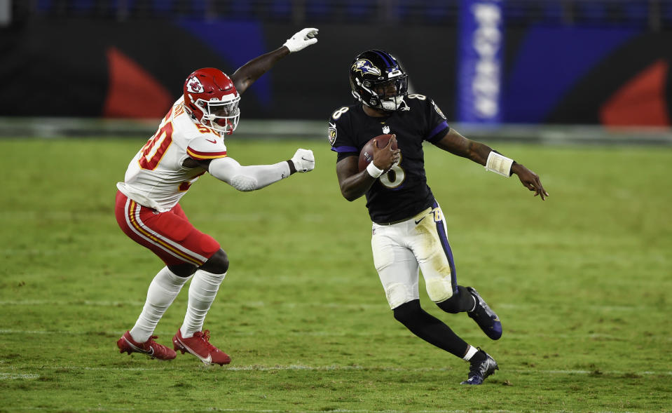Baltimore Ravens quarterback Lamar Jackson (8) scrambles away from Kansas City Chiefs linebacker Willie Gay Jr. (50) during the second half of an NFL football game, Monday, Sept. 28, 2020, in Baltimore. (AP Photo/Gail Burton)
