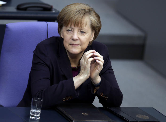 German Chancellor Angela Merkel attends a meeting of the German parliament, Bundestag, in Berlin, Thursday, March 20, 2014. Russia faces further sanctions from the European Union on Thursday over its annexation of the Crimea Peninsula as tensions in the region remained high despite the release of a Ukrainian naval commander. In an address to the German Parliament, Chancellor Angela Merkel said the EU was readying further sanctions and that the G-8 forum of leading economies had been suspended indefinitely. Russia holds the presidency of the G-8 and President Vladimir Putin was due to host his counterparts, including President Barack Obama, at a summit in Sochi in June. (AP Photo/Michael Sohn)