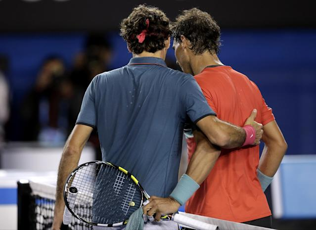 Rafael Nadal of Spain, right, is congratulated by Roger Federer of Switzerland at the net after Nadal won their semifinal at the Australian Open tennis championship in Melbourne, Australia, Friday, Jan. 24, 2014.(AP Photo/Rick Rycroft)