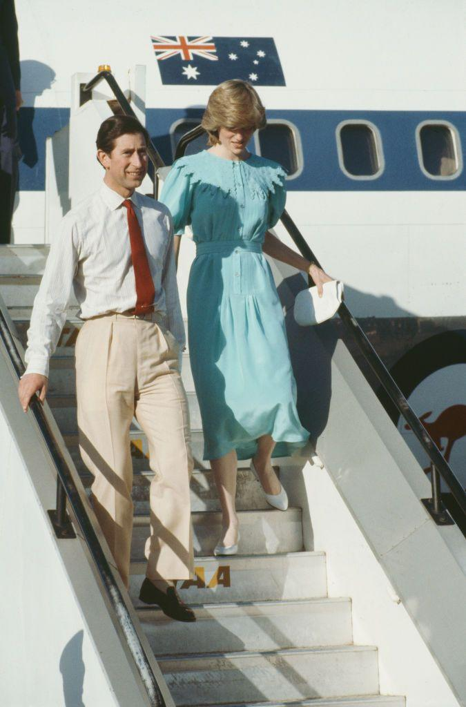 <p>During the 1983 Australia tour, Diana sported a teal dress with a belted waist, puff sleeves, and a scalloped bib collar.</p>