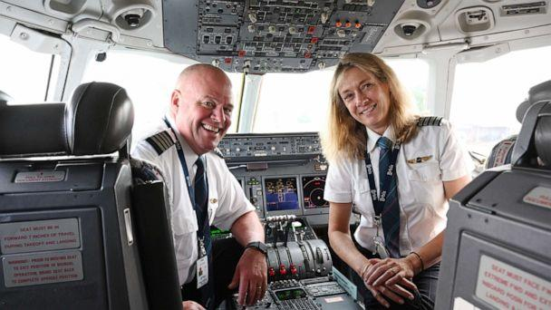 PHOTO: Peter and Cheryl Pitzer pose together in the cockpit of an Orbis plane. (Orbis)